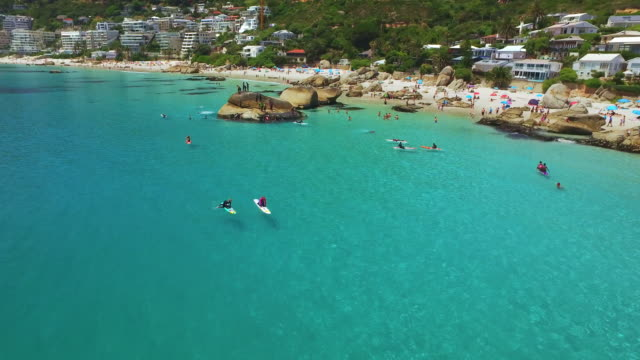 Time to hit the beach! Aerial drone footage of people enjoying a day at Clifton beach in the Western Cape, South Africa cape town stock videos & royalty-free footage