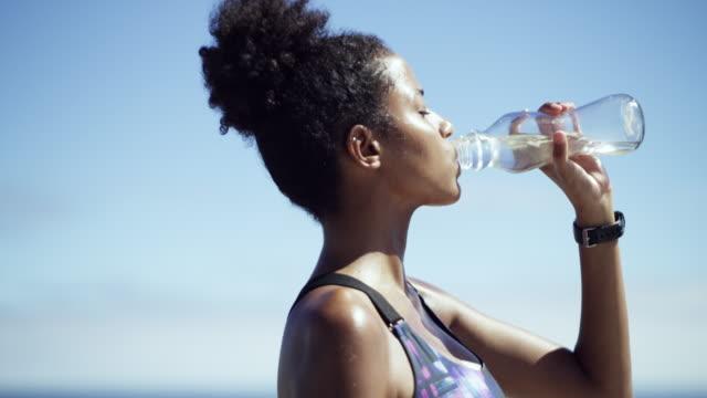 time to refresh and refuel your body - acqua potabile video stock e b–roll