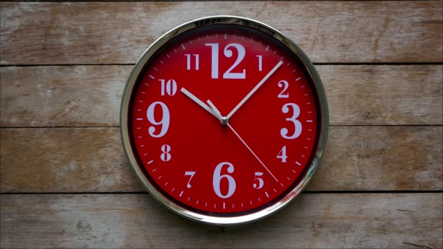 Time Red clock isolated on wood. Time lapse instrument of time stock videos & royalty-free footage
