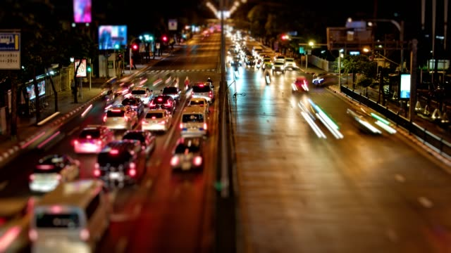 timelaps night, traffic on the roads of the city, many cars in the big city