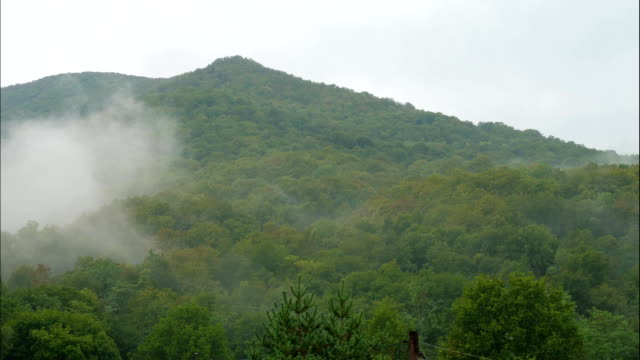 Timelaps of clouds appearing in mountains before rain video