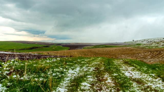 4K, TimeLaps. Snow fell on the spring agricultural fields, in the Aqsa Dzhabaglinsky Reserve, the Western Tian Shat. video