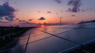 istock Time-lapse 4K large industrial Solar Energy Farm producing concentrated solar power.Day to night 1263831517