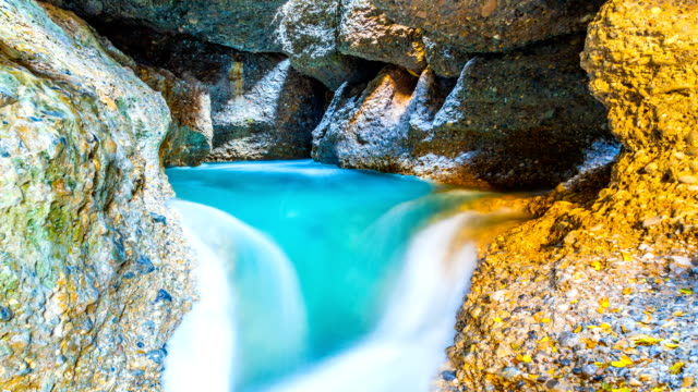 4K Timelapse. A colorful waterfall and a lake in a cave. Mountains of Central Asia video