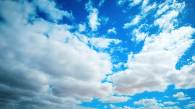Timelapse Aerial Shot Of Clouds Rolling In Blue Sky video