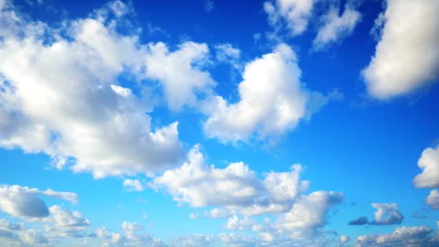 timelapse aerial shot of clouds rolling over blue sky - rotolare video stock e b–roll