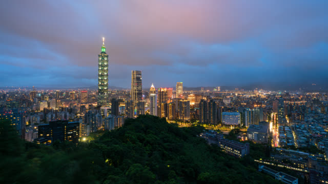 Time-lapse Aerial view of Business district in city of Taipei, Taiwan at night