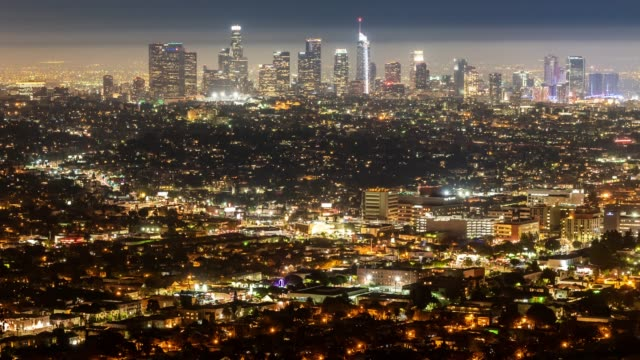 Time-lapse aerial view of Los Angeles Skyline building downtown and hollywood area sunset