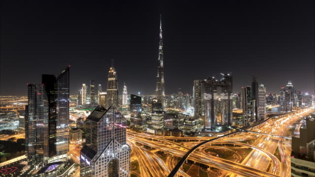 4K Timelapse - Aerial view of modern skyscrapers  and cityscape at night in Dubai UAE.