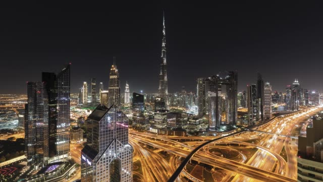 4k timelapse - aerial view of modern skyscrapers  and cityscape in dubai.uae - paesi del golfo video stock e b–roll