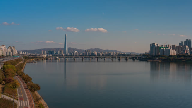 Timelapse Aerial view of Seoul downtown city skyline with vehicle on expressway and bridge cross over Han river in Seoul city, South Korea. Timelapse Aerial view of Seoul downtown city skyline with vehicle on expressway and bridge cross over Han river in Seoul city, South Korea. namsan seoul stock videos & royalty-free footage
