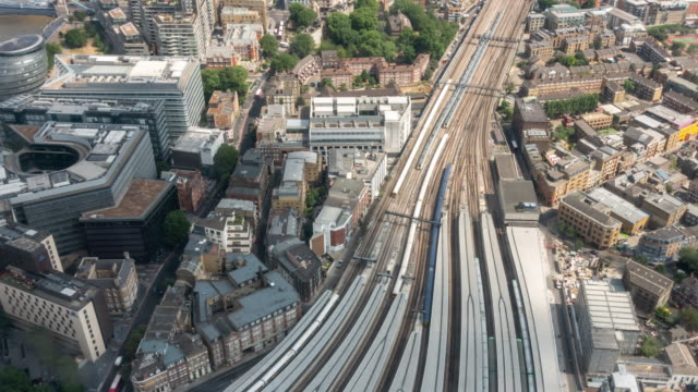 Time-lapse aerial view of train arrival and departure in London England UK