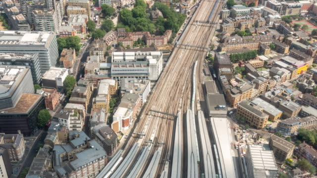 Time-lapse aerial view of train arrival and departure in London England UK 4K Time-lapse aerial view of train arrival and departure in London England UK, Apple ProRes 422 (HQ) 3840x2160 Format railing stock videos & royalty-free footage