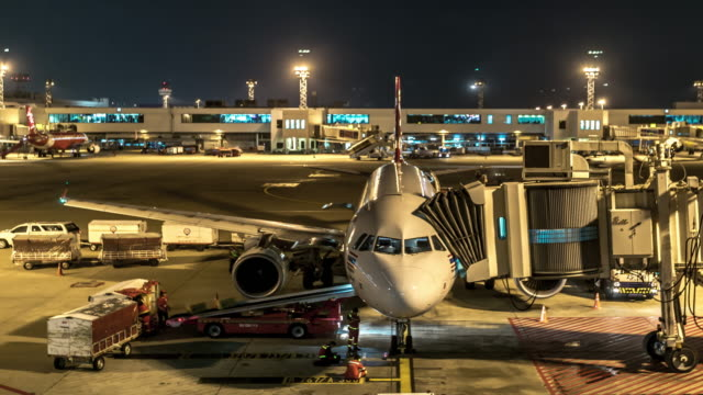 4K Time-Lapse: Airplane Arrive and depart from Jetway Dock night video