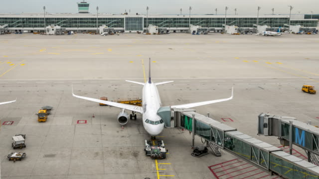 4K Time-Lapse: Airplane depart from Jetway Dock 4K Time-Lapse: Airplane depart from Jetway Dock, Apple ProRes 422 (HQ) 3840x2160 Format gate stock videos & royalty-free footage