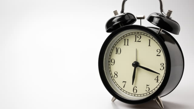 Time-lapse : Alarm clock motion shows passing time, 4k Resolution.