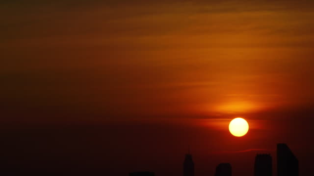 Time-lapse and Tilt down: sunset of cityscapes in bangkok, thailand. Time-lapse and Tilt down: sunset of cityscapes in bangkok, thailand. sunset to night time lapse stock videos & royalty-free footage