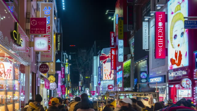 Timelapse at Myeong-dong Market.People walking on a shopping street at night, Seoul, South Korea Timelapse at Myeong-dong Market.People walking on a shopping street at night, Seoul, South Korea korea stock videos & royalty-free footage