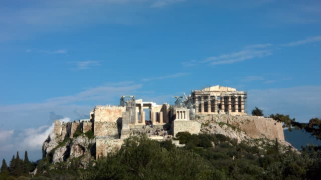 Timelapse - Athens - Greece - View of the Acropolis from the hill of Filopappou while tourists are visiting the monument video
