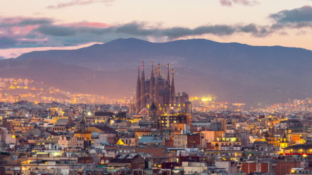 Timelapse Barcelona city skyline and Sagrada Familia at twilight