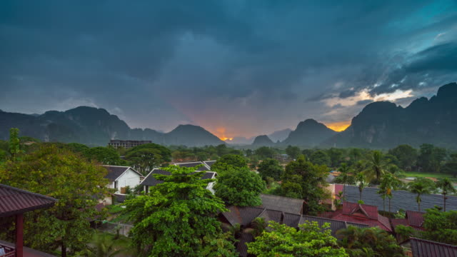 4K Time-lapse : Beautiful sunset at Viewpoint in Vang Vieng, Laos 4K Time-lapse : Beautiful sunset at Viewpoint in Vang Vieng, Laos southeast stock videos & royalty-free footage