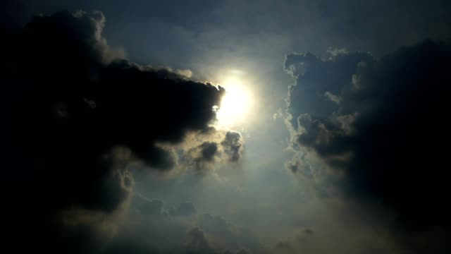 Timelapse black clouds and afternoon sun video