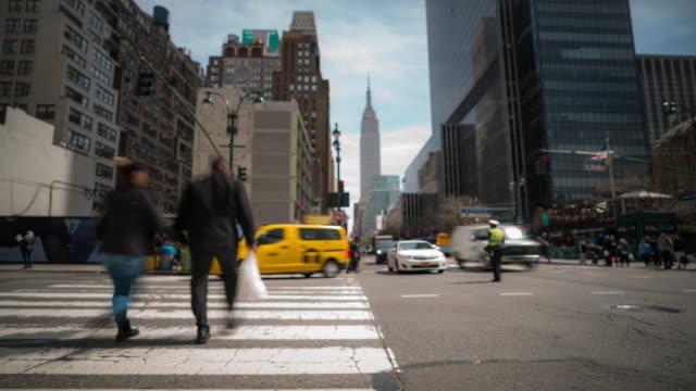 Time-lapse: Blurred background Tourist Pedestrians Crowd around Madison Square Garden Pennsylvania Station in New York USA