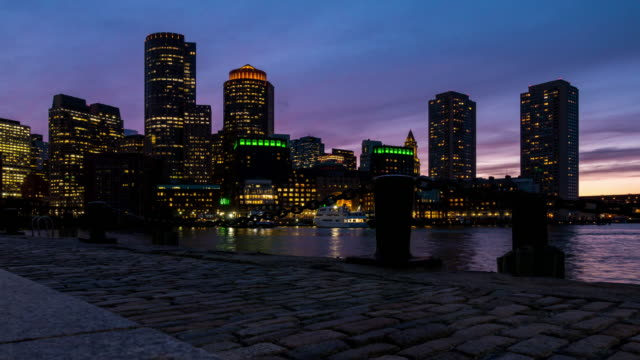 Time-lapse: Boston cityscape skyline building with boston bay from Fan pier Park MA USA sunset twilight