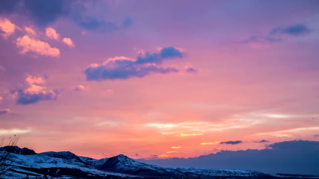 4K Timelapse. Bright pink sunset in the mountains video