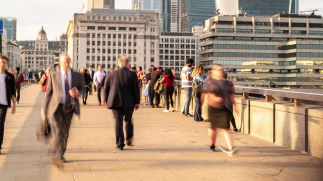 Time-lapse: Businessman Crowd at London bridge and downtown skylines building in London England UK
