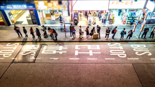 4K Timelapse - Busy Bus Stop at Mong Kok, Hong Kong 4K Timelapse - Long Queue of people waiting for Bus, Mong kok bus stop stock videos & royalty-free footage