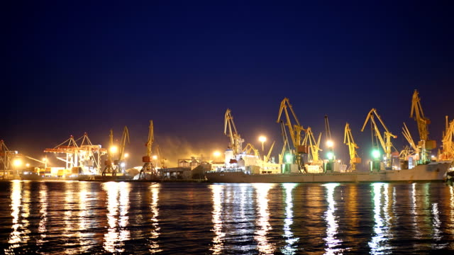 4K Timelapse, cargo ship moving load at port of Odessa. Night Time lapse video