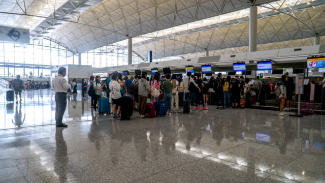 4k timelapse - check-in queue in hong kong airport - airports stock videos & royalty-free footage