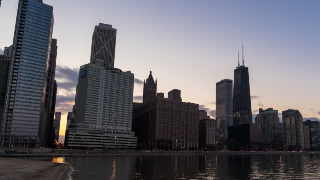 Time-lapse: Chicago Cityscape Office Skyline Skyscraper Building from Ohio Street Beach IL USA at sunset twilight