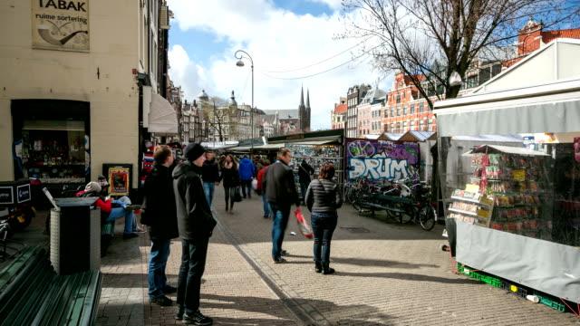 hd :time -lapse (低速度撮影) 街の歩行者天国のショッピング街、アムステルダム、フラワーマーケット - 花市場点の映像素材/bロール