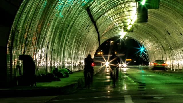 timelapse city tunnel traffic and homeless man - homelessness stock videos & royalty-free footage