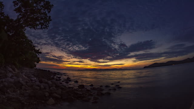 Time-Lapse : cloud moving over the sea while sunset or sunrise