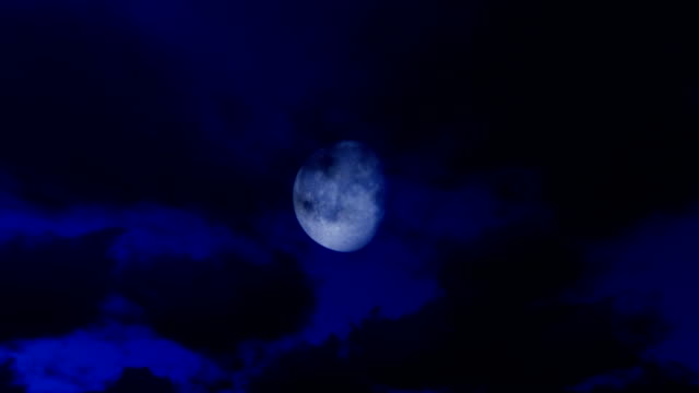 Timelapse clouds against full moon, night to day