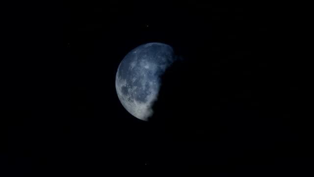 Timelapse clouds against full moon, sunrise