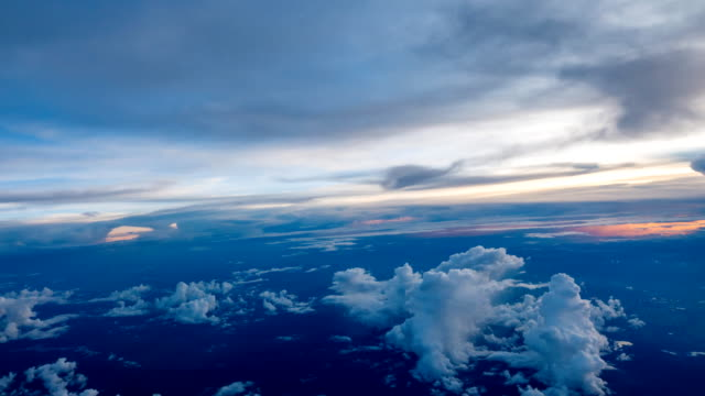 Timelapse clouds moving view through an airplane window. video