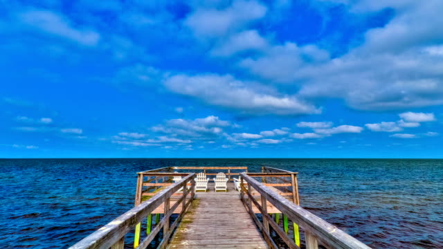 stockvideo's en b-roll-footage met time-lapse cloudscape of ocean pier with chairs in hd - pier