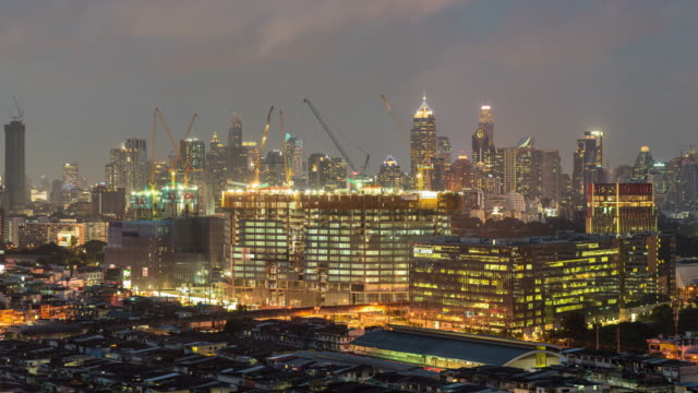 Time-lapse : construction building site in the city at night Time-lapse : construction building site in the city at night civil engineering stock videos & royalty-free footage