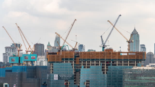 Time-lapse : construction building site in the city. developing industrial country concept