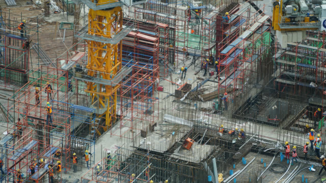 4K Time-lapse construction crane and building architecture video