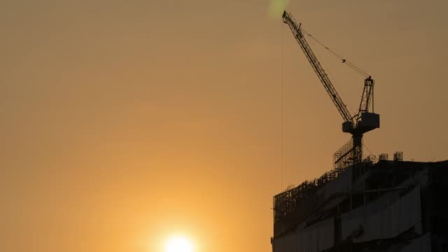 4K Timelapse: Cranes in construction site.