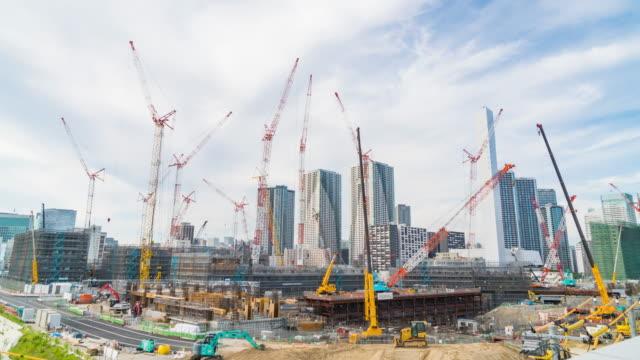 4K Timelapse: Cranes in site construction.