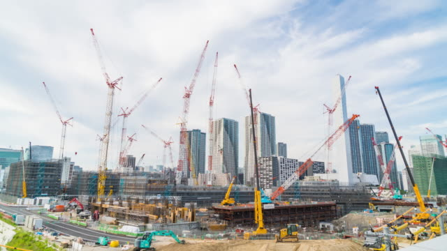 4K Timelapse: Cranes in site construction. 4K Timelapse: Cranes in site construction in Tokyo city. construction machinery stock videos & royalty-free footage