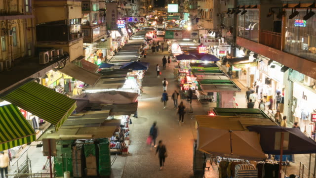 Time-Lapse: Crowd of people visit local tradditional market in Mong Kok district - vídeo