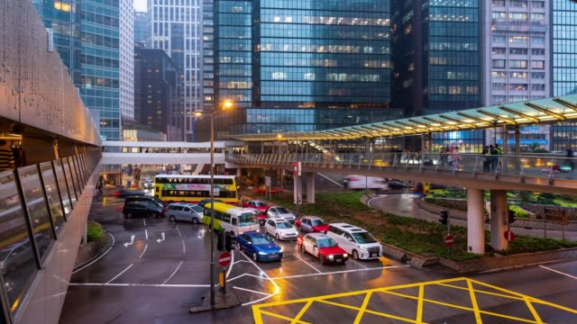 Time-lapse: crowded and transportation background in central Hong Kong downtown at sunset time