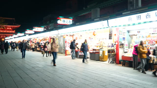 Timelapse : Crowded people in Market around Asakusa temple at Tokyo Japan video